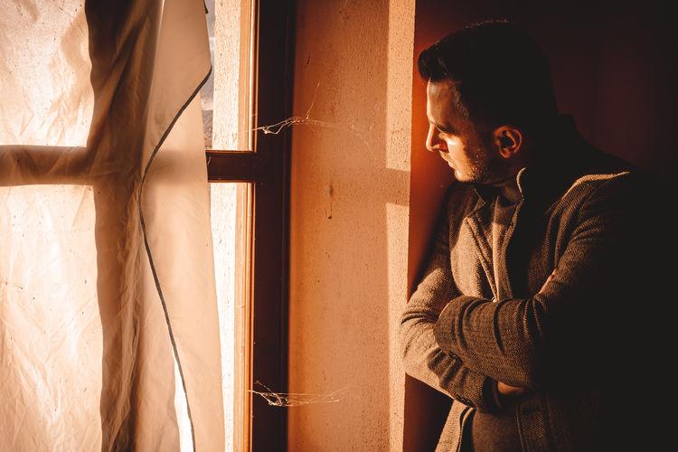 Man standing by window