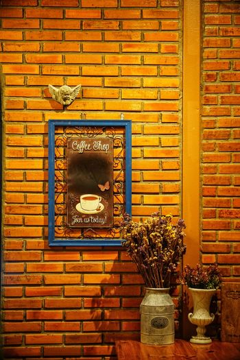 Coffee Shop Indoors  Interior Dried Flowers No People No Person Day Brick Wall Architecture Close-up Built Structure Brick Wall Wall - Building Feature Mounted Tiled Wall