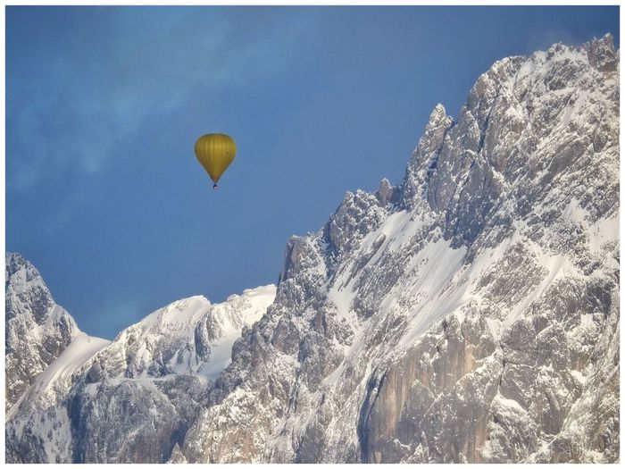Adventure Beauty In Nature Cold Temperature Day Hot Air Balloon Landscape Low Angle View Mountain Mountain Peak Mountain Range Nature No People Outdoors Rock - Object Scenics Sky Snow Tranquil Scene Tranquility Travel Destinations Winter