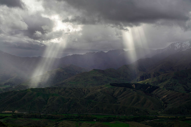 Spezial light from the sky to a brethtaking landscape Cloud - Sky Sunbeam Landscape Nature Outdoors Mountain No People New Zealand Photography Wanaka Mood New Zeland  Travel Destinations Beauty In Nature Rain Sun Light Travel Hiking Springtime Loneliness Scenics Day Mood Captures