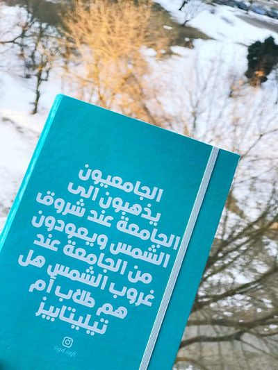 Snow Notebook Arabic Text Day Communication Outdoors No People Tree Close-up