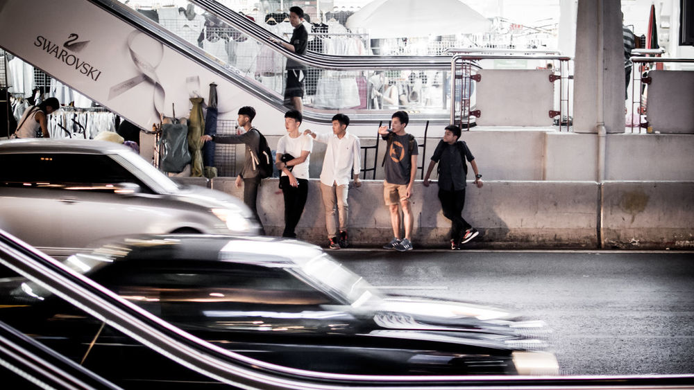 Teenager calling taxi beside road in Bangkok Bangkok Blurred Motion Calling Car City Life Land Vehicle Leisure Activity Lifestyle Lifestyles Mode Of Transport Real People Siam Square Side View Speed Standing Street Street Photography Teen Teenager Teens Transportation Waiting Waiting For Taxi My Commute My Commute-2016 EyeEm Photography Awards