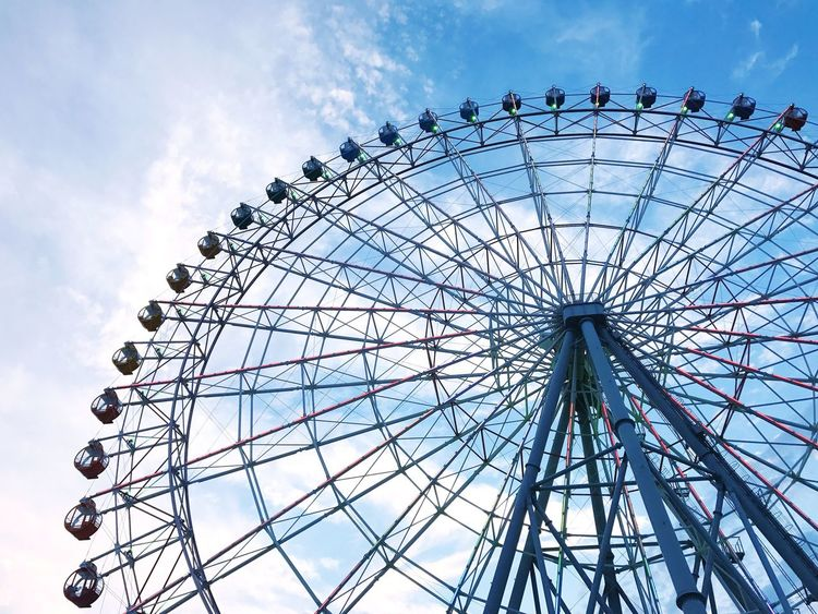 Ferris wheel under blue sky Ferris Wheel Low Angle View Sky Big Wheel Outdoors Blue Sky OSAKA Japan Rinku Town