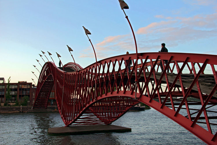 The Python bridge in Amsterdam Amsterdam Architecture Architecture_collection Blue Sky Bridge Python Bridge Red Red Bridge Your Amsterdam Telling Stories Differently The Architect - 2016 EyeEm Awards