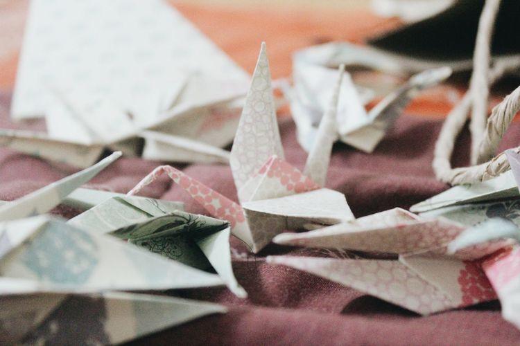 Full frame shot of paper origami on table