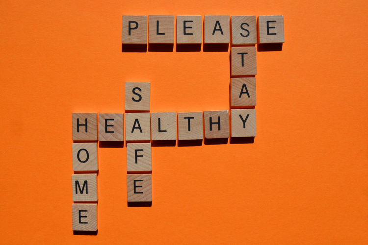 Close-up of text on orange wall