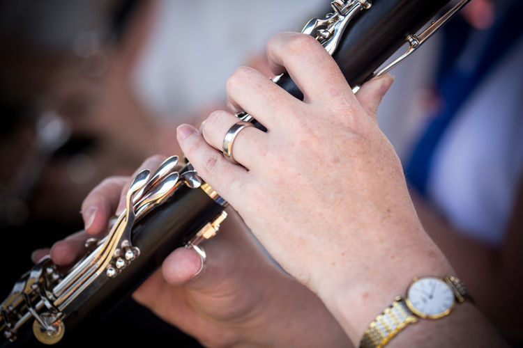 Close-up of woman hands playing musical instrument