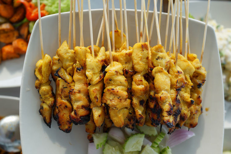 Satay, grilled chicken, Malaysian Cuisine BBQ Grilled Chicken Malaysian Food Asian Food Close-up Day Food Freshness No People Plate Ready-to-eat Satay Skewered Chicken Top View Food Stories