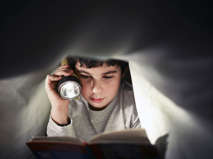 Portrait of a boy with open book