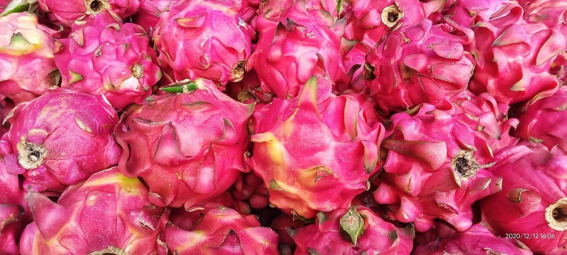 Full frame shot of pink fruits for sale in market