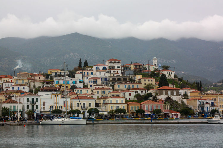 Town by sea against sky in city