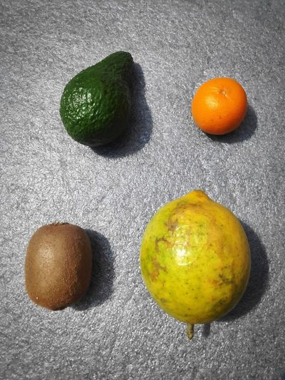High angle view of oranges against white background