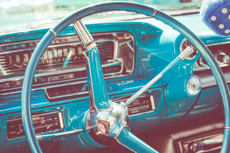 American 1957 Cadillac Coupe De Ville Steering Wheel & Driving Console 1957 American Cadilac Coupe Deville Cadillac Cadillac Coupe Coupe Deville Furry Dice Ludgershall Village Fete Azure Blue Blue Buckinghamshire Car Close-up Day Dice Driving Console Ignition Mode Of Transport No People Old-fashioned Outdoors Retro Styled Steering Wheel Transportation Vintage Car