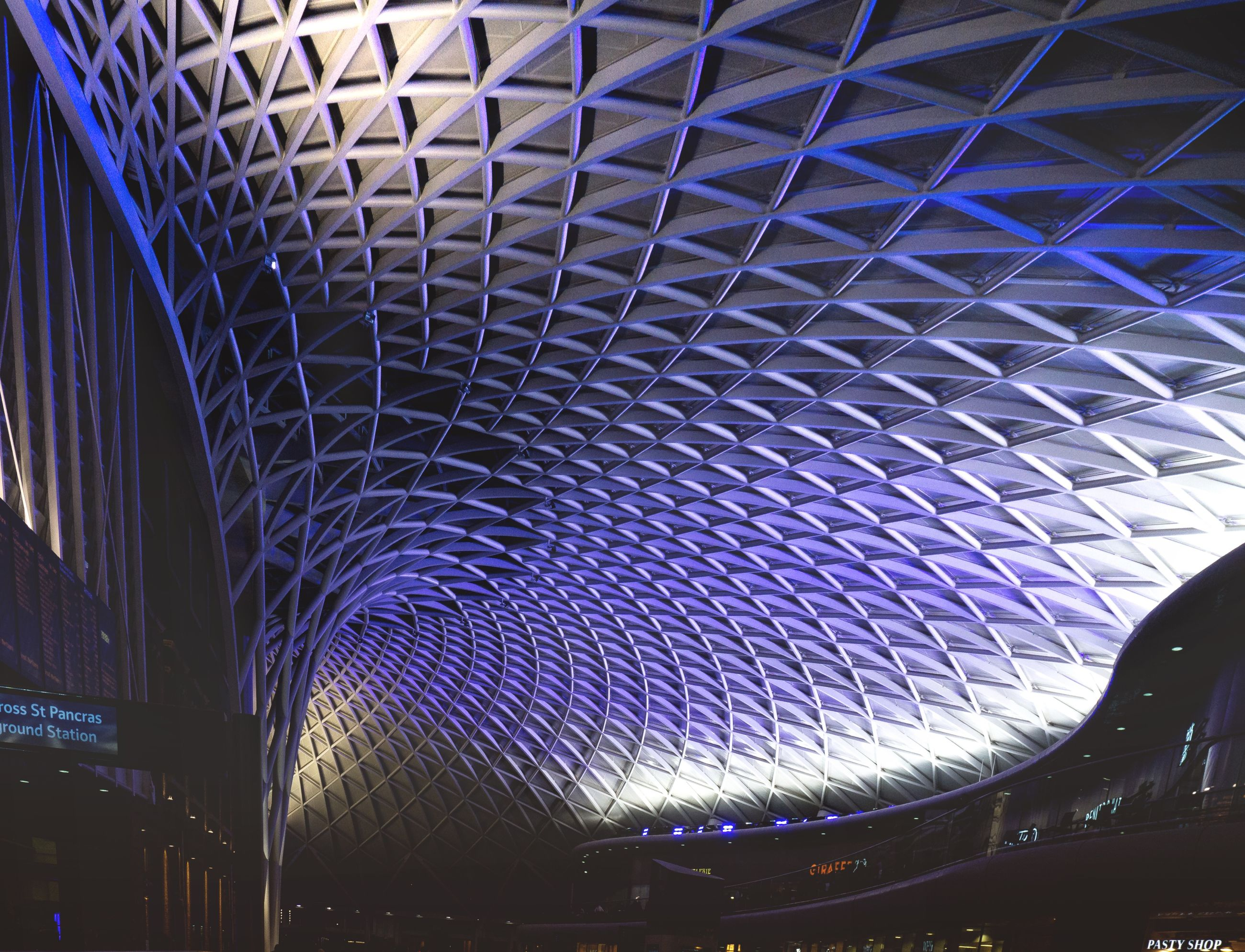 ceiling, pattern, architecture, illuminated, indoors, built structure, modern, lighting equipment, low angle view, no people, night, design, architectural feature, architecture and art, transportation, light, metal, blue, railroad station, purple