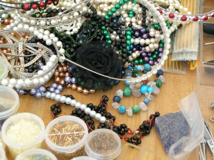 High angle view of various fashion jewelries on table