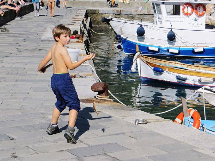 People Of The Oceans Fishing Summer Weekend Activities Outdoors Free Freedom Playing Enjoying The Sun Having Fun Kids Kid Boy Childhood Summertime Springtime Spring Cinque Terre Enjoying Life See Water Boats Boat Port Children