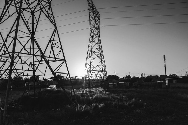 IT'S A NEW DAY... Electricity Pylon Silhouette Electricity  Cable Power Line  Steel Technology Sky No People Grass Construction Frame Outdoors Day Golf Club Oil Pump EyeEm EyeEm Gallery EyeEm Selects South Africa Winter Walking Faces Of Africa Faces Of EyeEm Rural Scene Close-up The Week On EyeEm Humanity Meets Technology