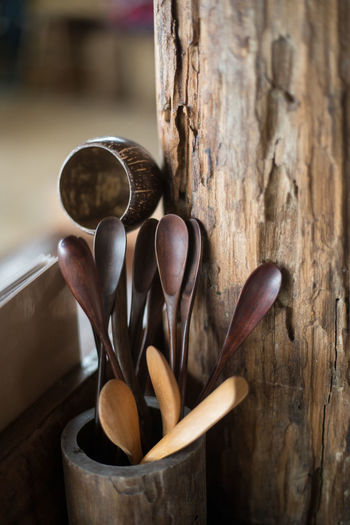 Close-up of wooden spoons in container