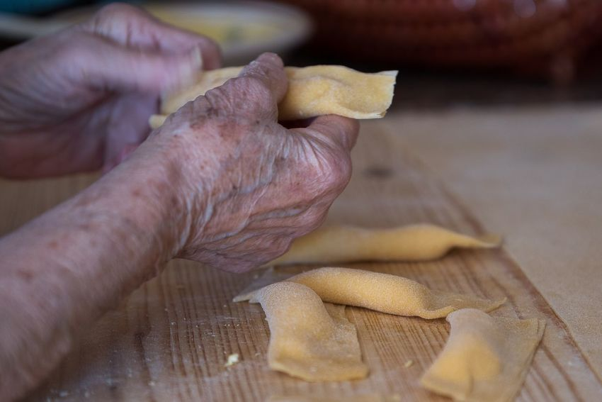 Hands of old woman making ravioli Pasta Human Hand Human Body Part One Person Food And Drink Real People Holding Food People Close-up