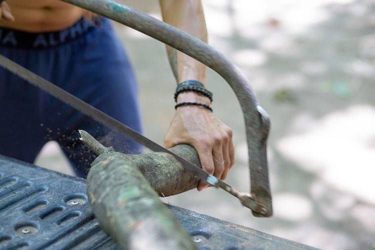 Low angle view of man working on metal structure