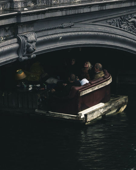 High angle view of people sitting on boat