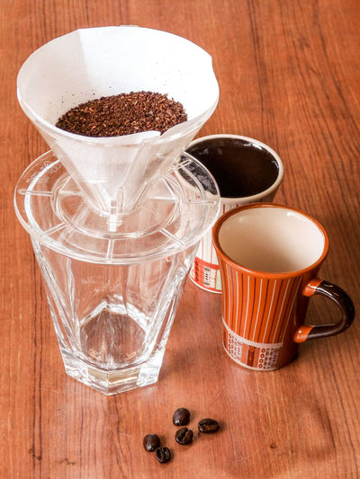 Beverage Brew Close-up Coffee Coffee Cup Composition Cup Drink Drinking Glass Drip Food And Drink Glass Indoors  Indulgence Preparation  Refreshment Still Life Table Temptation コーヒー コーヒー豆 ドリップコーヒー 飲み物 飲料