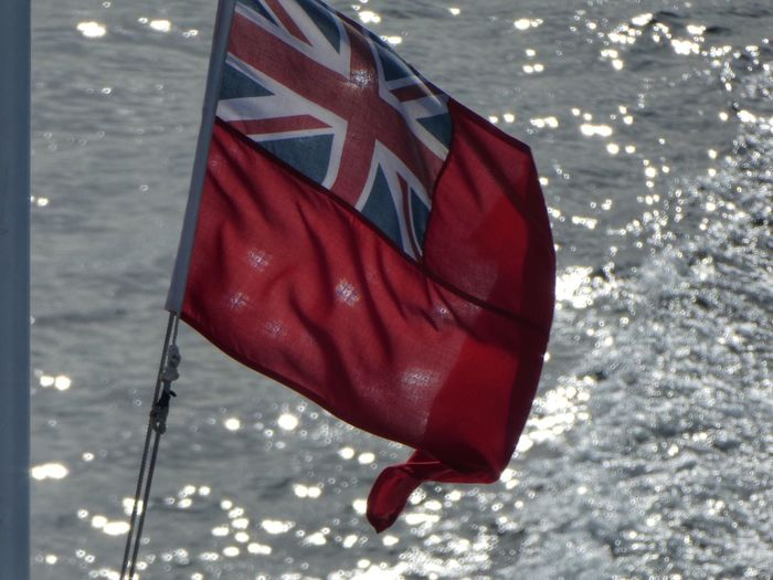 Shimmering Red Ensign Flag Highlands Of Scotland Sea And Sky Flag Red Ensign Ferry Bon Voyage Travel Photography VisitScotland Red Flag Patriotism Star Shape Nature No People Water Day Shape Pride Outdoors Emotion Freedom Symbol Close-up Symbolism Hanging High Angle View Wind Independence