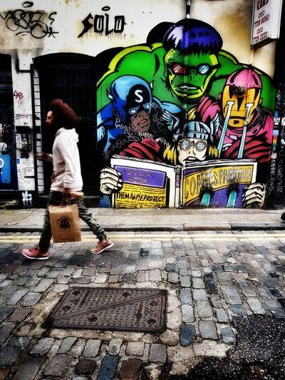 Full length of man walking on multi colored city street