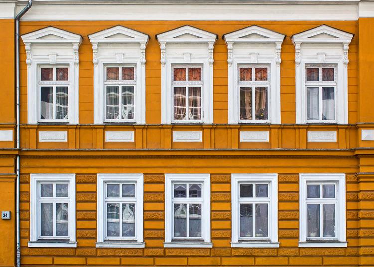 East Berlin's Colors. FILIPPI GIULIA PHOTOGRAPHY. Architecture Berlin Building Exterior Built Structure Canon City Colors Day Façade Geometric Shape Germany Glass House Orange Color Outdoors Pattern People Photography Photooftheday Picoftheday Reflection Repetition Streetphotography Urban Window