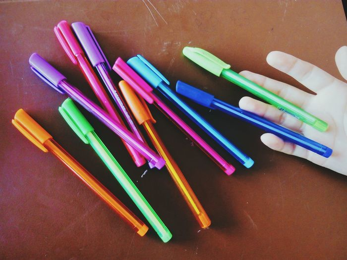 High angle view of multi colored ballpoint pens