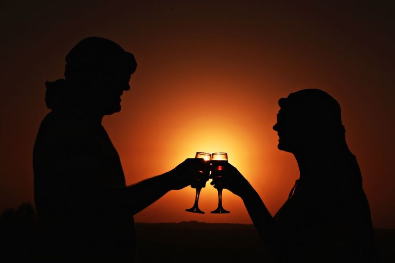 Wine Not Sunset Silhouette Orange Color Two People Real People Side View Togetherness Beauty In Nature Desert Sunset_collection Dubai Wine Not