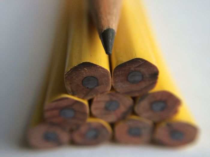 High angle view of pencils against white background