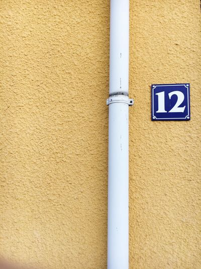 Number 12 by pipeline on wall