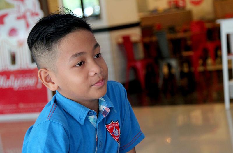 Close-Up Of Cute Boy At School