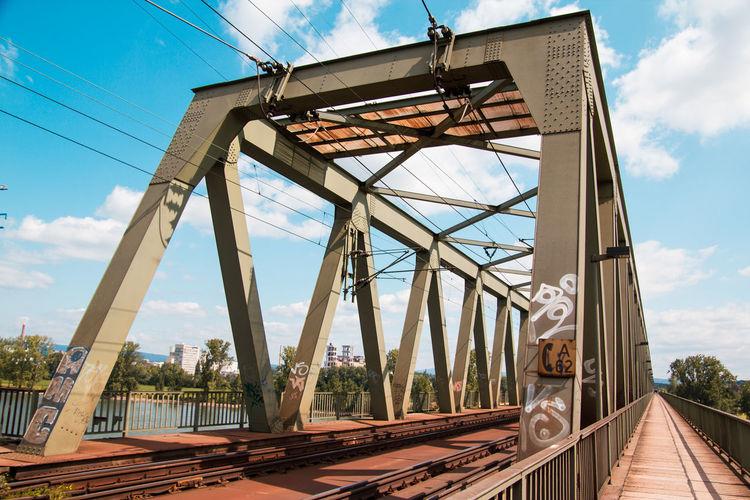 Railway bridge against cloudy sky