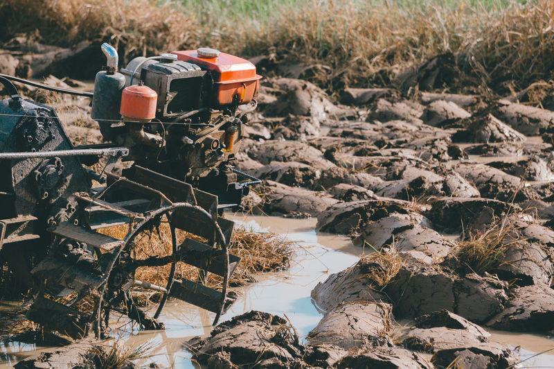 View of machine on muddy land