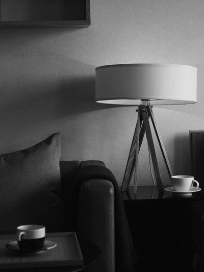 Coffee Cups On Table With Lamp At Home