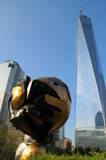 New York City Sphere Statue WTC WTC Memorial Architecture Building Exterior Built Structure City Clear Sky Day Destroyed Low Angle View Lower Manhattan Modern Monument No People Park Sculpture Sculpture In The City Skyscraper Statue The Sphere World Trade Center World Trade Center One