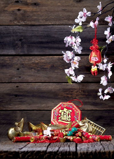Chinese New Year Lunar New Year Good Luck Decoration Festive Wooden Table Luck Mascot Flat Lay Celebration Craft Firecrackers Ornament Gold China 2020 2019 Pig Minimal Sales Envelope Celebrations Flowers Lucky Tradition Symbol Red Fu Background Festival Spring Holiday Traditional Gold Culture Oriental Fortune Asian  ASIA Packet Plum Blossom Design Celebrate Greeting Prosperity Auspicious Money Happiness Firecracker Ingot Wood - Material Flower No People Food And Drink Food Flowering Plant Nature Freshness Plant Art And Craft Christmas Indoors  Representation Close-up Snack