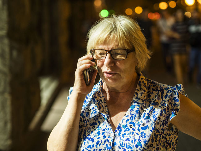 Middle aged caucasian woman using smartphone at the night street Woman Aged Caucasian Close-up Day Eyeglasses  Focus On Foreground Front View Lifestyles Middle Night One Person Outdoors People Real People Senior Adult Smartphone Street Using