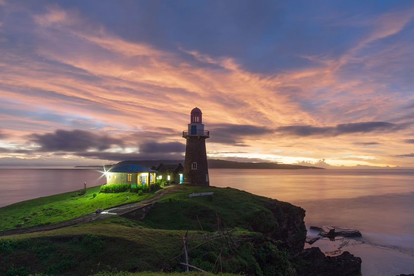 The sunrise of Sabtang Light House is one of the iconic place that ive visited in Batanes. The Batanes located in the upper part island of the Philippines. The Traveler - 2018 EyeEm Awards Water Sea Lighthouse Nautical Vessel Horizon Sunset Beach Nautical Equipment Beauty Business Finance And Industry