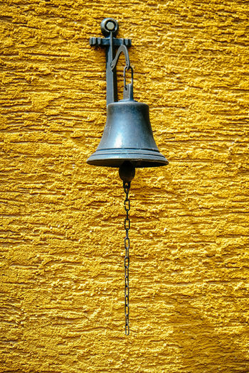 Bell Architecture Building Exterior Built Structure Day Electricity  Gas Light Lighting Equipment Low Angle View Nature No People Outdoors Wall Lamp Yellow