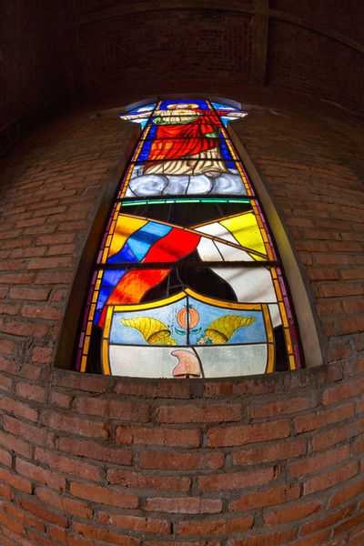 CABRERA, COLOMBIA - MAY 7: fisheye view of astained glass window at a church in Cabrera, Colombia on May 7, 2016. American Beautiful Chapel Colombia Latin South Stained Glass Tourist Travel America Attraction Brick Cabrera Colombian  Colonial Cundinamarca Destination Historical History Indoors  Low Angle View Old Place Of Worship Tourism Window