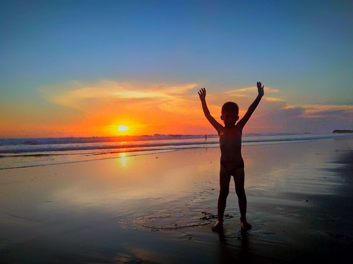 Beach Bali Sunset Sea Water Arms Raised Shore Beauty In Nature Sand One Person Sky Horizon Over Water Nature Lifestyles first eyeem photo