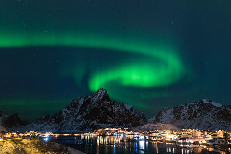 Night Nature Sky Landscape Travel Norway Mountain Vacations Aurora Norge Aurora Borealis Lofoten No People Green Color Polar Lights Green Lady Norway Nature Star - Space Northern Lights Beauty In Nature Scenics - Nature Majestic Snow Tranquility Tranquil Scene Outdoors Space And Astronomy Cold Temperature Idyllic Water Illuminated Reine Scandinavia Phenomenon