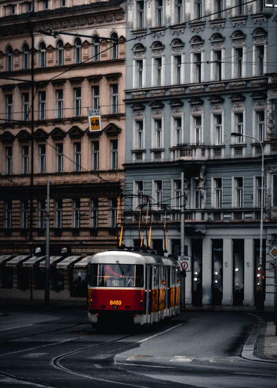 Building Exterior Architecture Built Structure City Mode Of Transportation Transportation Building Street Public Transportation Day Land Vehicle Residential District Rail Transportation No People Window Motion Outdoors City Life Railroad Track Track Apartment Tram Prague Streetphotography