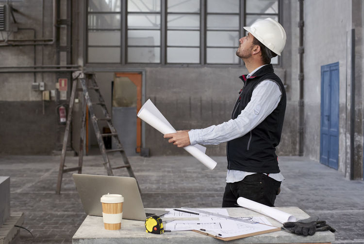 Side view of a man working
