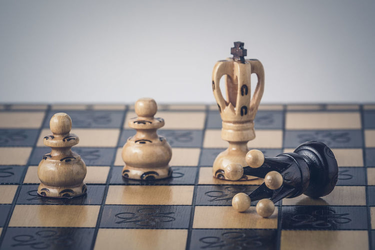 Close-up of chess pieces on table