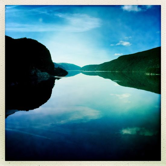 Sky Water Reflection Cloud - Sky Tranquil Scene Day Outdoors Nature Scenics Lake Beauty In Nature Tranquility Waterfront Silhouette No People Mountain Close-up Norway Lake View