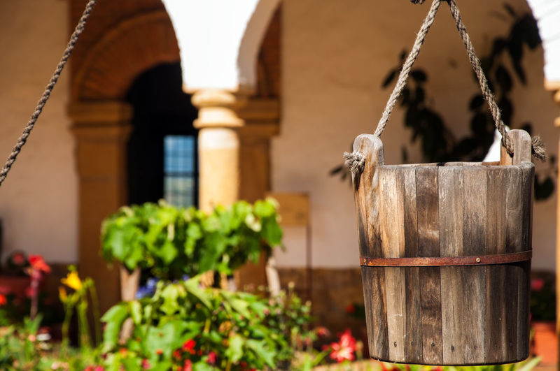 Wooden bucket hanging at courtyard